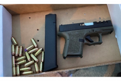 Police: Gun found in vehicle of man who tried to flee from traffic stop