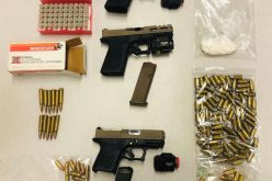 Three guns, ammo and cocaine all seized in traffic stop