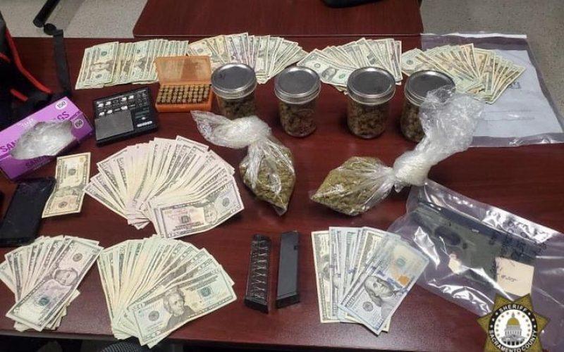 Man flees vehicle stop with gun, drugs, cash