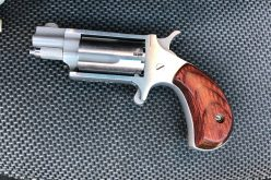 Stolen handgun confiscated, two arrested during traffic stop