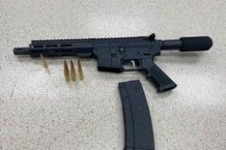 Modified loaded AR-15 with one in the chamber