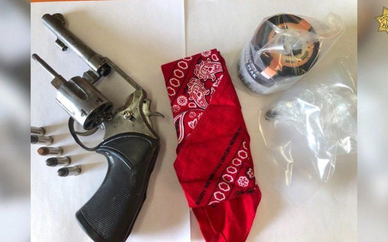 Gang member tries to run with gun, drugs