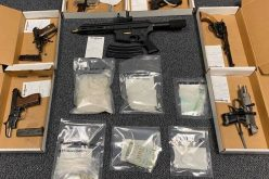 Probation check yields guns and drugs
