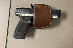 Traffic violation leads to the arrest of a parolee at large with a gun