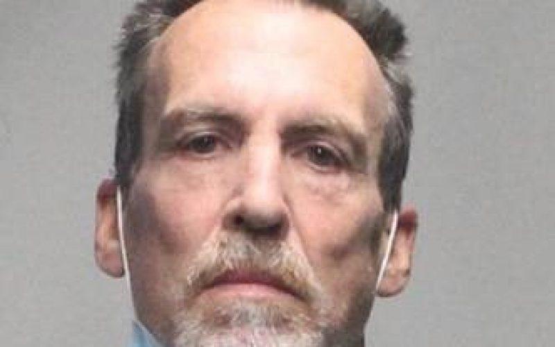 Probationer arrested for carrying gun