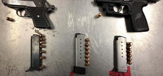 Two arrested carrying two guns