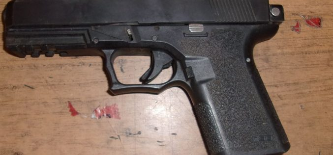 Search warrant leads to woman's arrest for gun