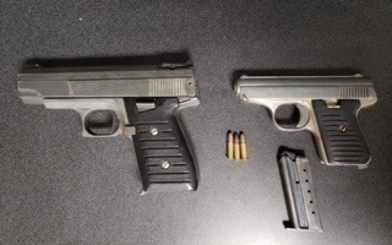 Man arrested with two guns, other traffic offenses