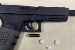 Pair arrested with stolen gun, pills, meth, pipe