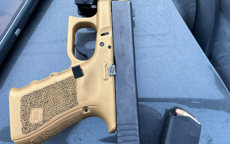 Suspect Arrested in Stolen Vehicle with Unregistered Firearm