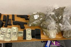 Man with gun and drugs tries to walk away from traffic stop