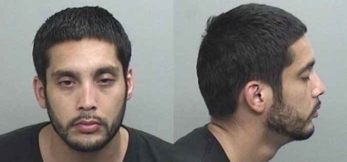 Man with warrant, drugs, fraudulent checks, pipe