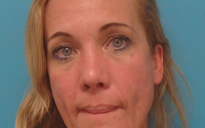 Woman arrested for assault with a knife